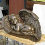 Ширина скульптуры ангела - 50 см. Модель детской скульптуры. Стоимость ангела из полимера - $1 тыс.