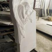 Памятник с барельефом ангела. Размеры памятника: 130 х 70 х 15 см. Цена памятника с барельефом - $4,6 тыс.
