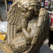 Фото ангела из полимера. Размеры ангела из полимера: 54 х 57 х 21 см. Перевод модели скульптуры из пластилина в полимер.