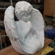 Скульптура из полимера. Высота ангела из полимера - 56 см., глубина скульптуры - 30 см., ширина скульптуры ангела - 60 см.