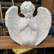 Фото ангела из полимера. Размеры ангела из полимера: 56 х 60 х 30 см. Стоимость ангела из полимера - 12 тыс. грн.
